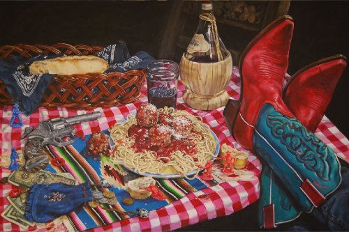 Table set with a meal of spaghetti and meatballs surrounded by Western toys