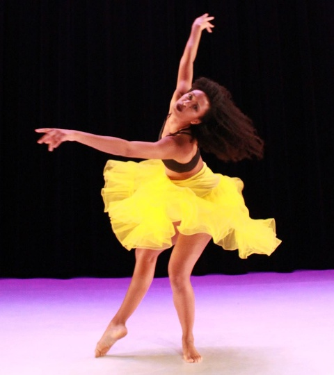 Young woman dancing with her short skirt twirling