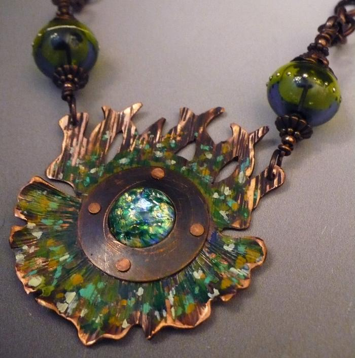 Necklace of copper metal and blue/green abstract patterns