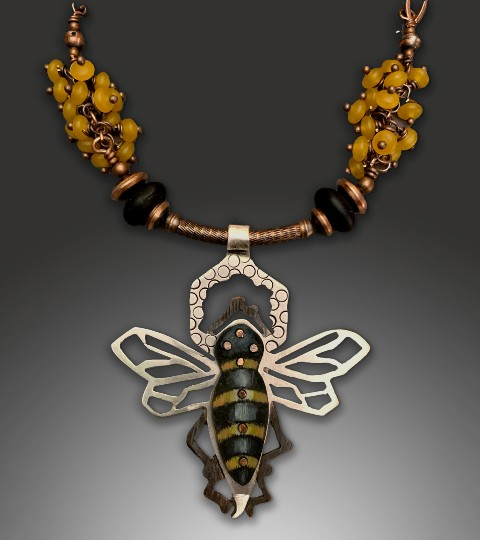 Necklace of honey-colored beads and metal bee