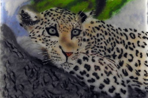 Leopard perched in a tree, glass artwork