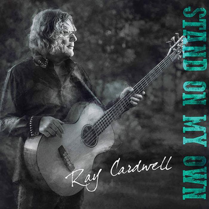 Photo of man holding guitar